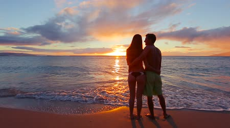 sunset sea : Happy Young Romantic Couple Walking on the Beach Enjoying the Sunset. Smooth Steadicam Motion