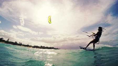acrobata : Young Woman Kitesurfing in Ocean. Extreme Summer Sport HD. Slow Motion.
