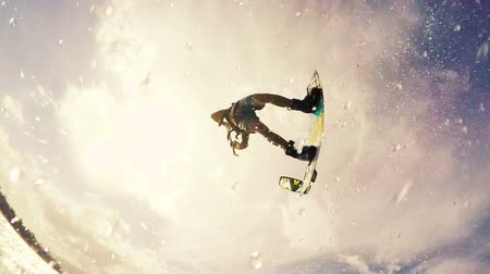 acrobata : Young Man Jumps Huge Over Camera Kitesurfing in Ocean. Extreme Summer Sport HD. Slow Motion. Stock Footage