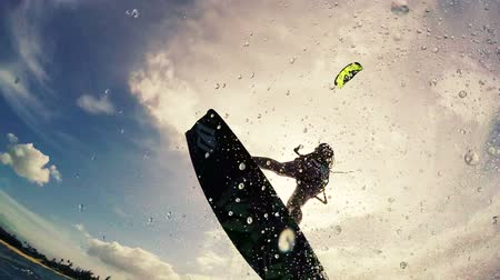 extremo : Young Woman Catches Air Kitesurfing in Ocean. Extreme Summer Sport HD. Slow Motion. Vídeos