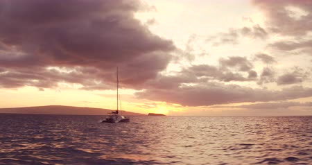 navio : Sailing into the Sunset. Aerial View Flying Over Sail Boat. Shot in 4K. Amazing Vibrant Sunset in Hawaii Vídeos