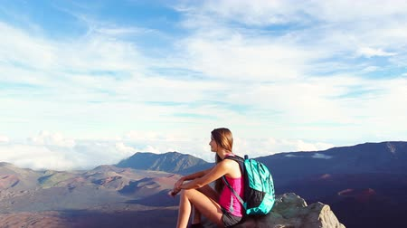 peak : Young Woman Sitting on top of Mountain with Backpack. Helthy Nature Adventure Lifestyle Stock Footage