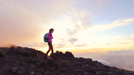 peak : Hike. woman hiker walking. Hiking girl walking alone in beautiful landscape nature at sunset