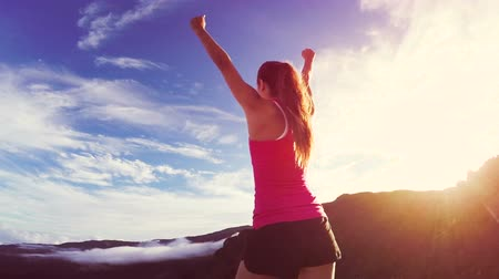 fitnes : Reaching The Top. Happy successful fitness woman raising arms to the sky at sunset. Success Wideo