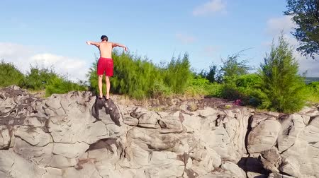 kayalık : Extreme Cliff Jumping Backflip. Summer Extreme Sports Shot from Above Aerial View. Stok Video