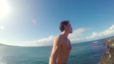 point of view pov : POV Slow Motion Cliff Jumping Backflip. Athletic Young Man Jumping From Cliff Into Ocean. Adventure Extreme Sports Lifestyle Hobby Vacation