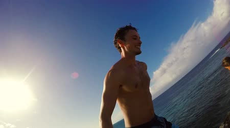 cliff : POV Slow Motion Cliff Jumping Backflip. Athletic Young Man Jumping From Cliff Into Ocean. Adventure Extreme Sports Lifestyle Hobby Vacation