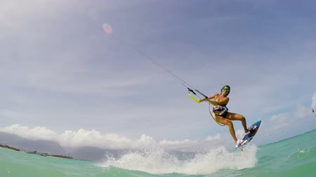 point of view pov : Young Woman Kitesurfing in Ocean in Bikini. Extreme Summer Sports Slow Motion.
