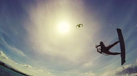 deski : Kite Boarding Extreme Summer Sports Slow Motion. Young Woman Kitesurfing in Ocean in Bikini.