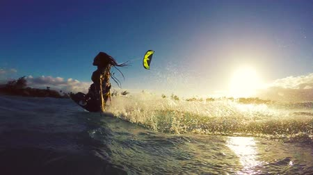 fitnes : Extreme Kitesurfing at Sunset. Summer Ocean Sport in Slow Motion. Girl Kite Surfing in Bikini Wideo