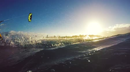 extremo : Extreme Kitesurfing at Sunset. Summer Ocean Sport in Slow Motion. Girl Kite Surfing in Bikini Vídeos
