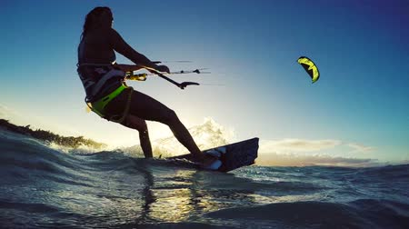 atletismo : Extreme Kitesurfing at Sunset. Summer Ocean Sport in Slow Motion. Girl Kite Surfing in Bikini Stock Footage