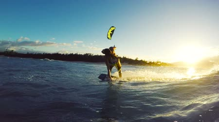 deski : Extreme Kitesurfing at Sunset. Summer Ocean Sport in Slow Motion. Girl Kite Surfing in Bikini Wideo
