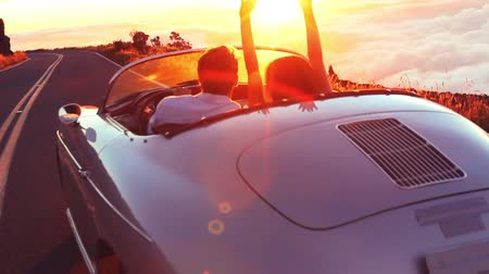 kabarık : Happy Couple Driving on Country Road into the Sunset in Classic Vintage Sports Car