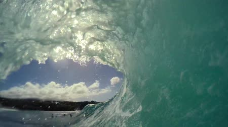barril : POV Surfing View Of Empty Ocean Wave Crashing. View from in the Barrel. Extreme Sport Slow Motion HD GOPRO Stock Footage