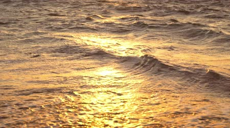sunset sea : Amazing Sunset Over Tropical Beach. Waves Roll up White Sand in SLOW MOTION. Luxury Resort Vacation