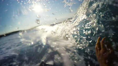szörfös : POV Man Surfing Ocean Wave, Extreme Sport HD Slow Motion. Surfer on Blue Ocean Wave Getting Barreled