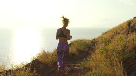 rotaları : Young Athletic Woman Running on Mountain Trail. POV Follow Cam. Sunset Workout in Nature.