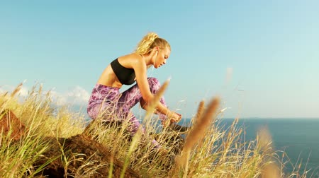 sportowiec : Young Athletic Woman Working out in Nature. Tying Shoes. Beautiful Sceneic Mountain View. Slow Motion