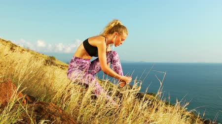 buty sportowe : Young Athletic Woman Working out in Nature. Tying Shoes. Beautiful Sceneic Mountain View. Slow Motion