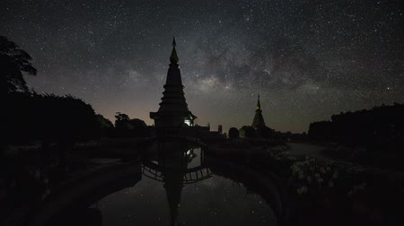 astro : The Milky Way galaxy moving over two Pagodas.