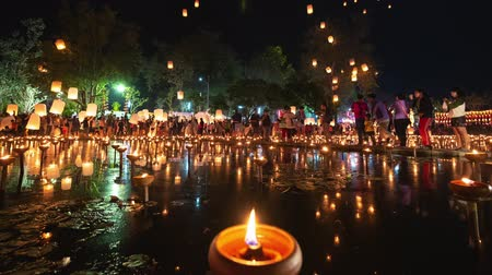 peng : 4K Timelapse of Floating lanterns and People in Yee Peng Festival or Loy Krathong celebration at Nong Bua, San  Kamphaeng, Chiang Mai, Thailand (Zoom-In)