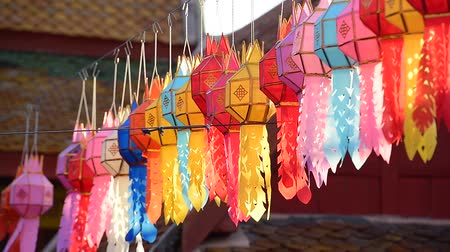 peng : Lanna lantern hang on the rope to wish a desire or hope for good thing to happen, in northern thai style lanterns at Loi Krathong (Yi Peng) Festival, Chiang Mai, Thailand Stock Footage