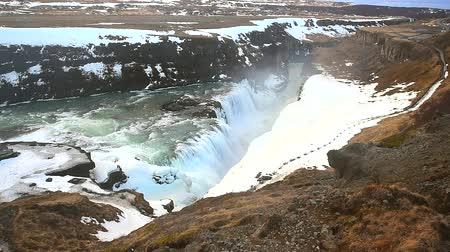 gullfoss : Gullfoss waterfall view and winter Landscape picture in the winter season, Gullfoss is one of the most popular waterfalls in Iceland and tourist attractions in the canyon of the Hvita river Iceland Stock Footage