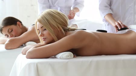 kamień : Women having stone therapy at spa session