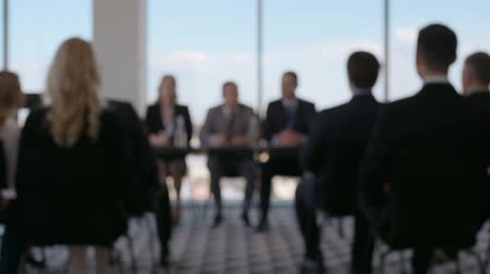 questionário : Defocused background of business people and speakers sitting in the conference room Stock Footage