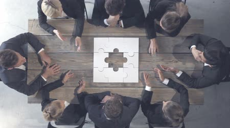 problem : Business people and puzzle on wooden table, business problem solution concept Stock Footage
