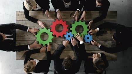 Business people with colorful cogs of business, problem solution concept