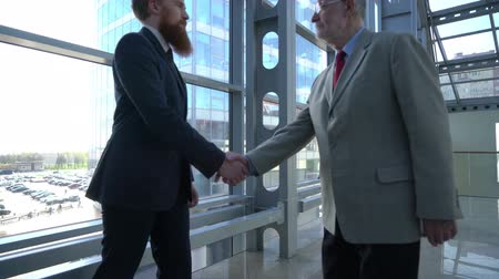 Business people shaking hands after presentation Stok Video
