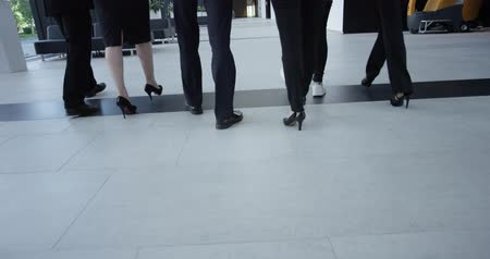 hall : Business people walking in modern office building hall