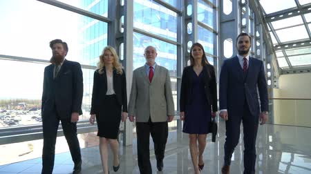 Business team walking in modern glass office building