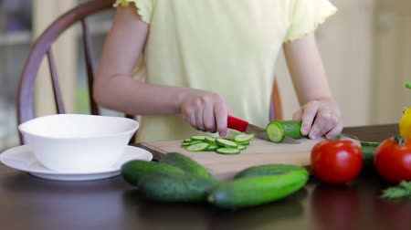 sağlıklı gıda : Little girl cutting vegetable for salad. Concept of healthy food. Stok Video