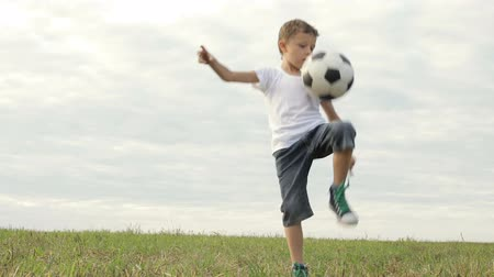 One happy little boy playing football. Concept of sport.