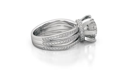 Jewelry engagement ring with diamonds. Seamless loop animation. 3D rendering