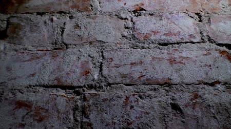 sıva : Background old brick wall with old worn bricks with holes in the wall Stok Video