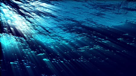 Water FX0310: Underwater ocean waves ripple and flow with light rays (Loop).