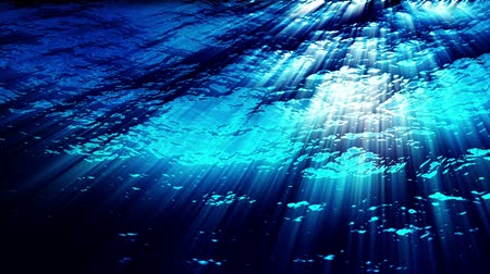 alatt : Water FX0325: Underwater ocean waves ripple and flow with light rays (Video Loop).