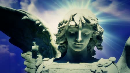 небесный : Angel 0111: The statue of an Angel on time lapse blue clouds (Video Loop). Стоковые видеозаписи