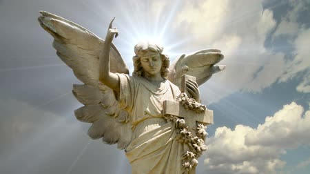 İncil : Angel 1001: Stock video of the statue of an Angel on time lapse clouds (Loop). Stok Video