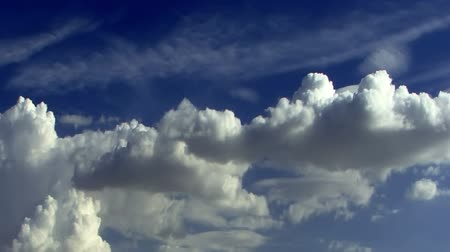 небесный : Fantastic Clouds 0104: Time lapse clouds travel across a blue sky.