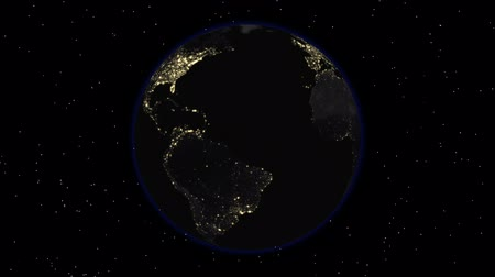 stratosphere : Earth 1003: Stock video of the dark side of the Earth with city lights visible (Loop). Stock Footage