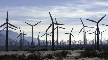 Wind Power 0106: Hundreds of windturbines turn in the California desert.