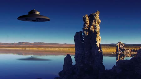 земной : UFO 004: A flying saucer over Mono Lake, California. Стоковые видеозаписи