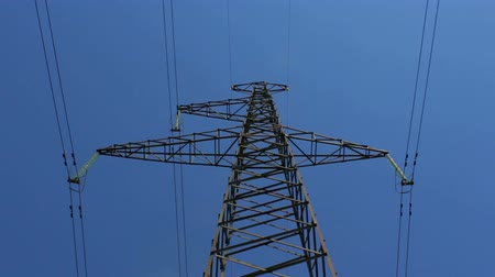 kable : electricity tower with high voltage metal with wires against the sky with clouds