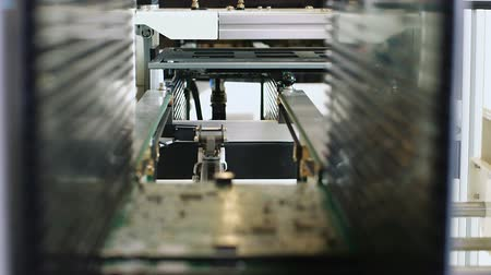 automatizálás : Detail view of Automated machine of production line PCB boards at work in factory