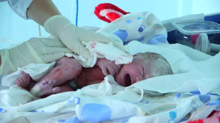 cesarean : female doctor taking care of a newborn child after Caesarean section Stock Footage